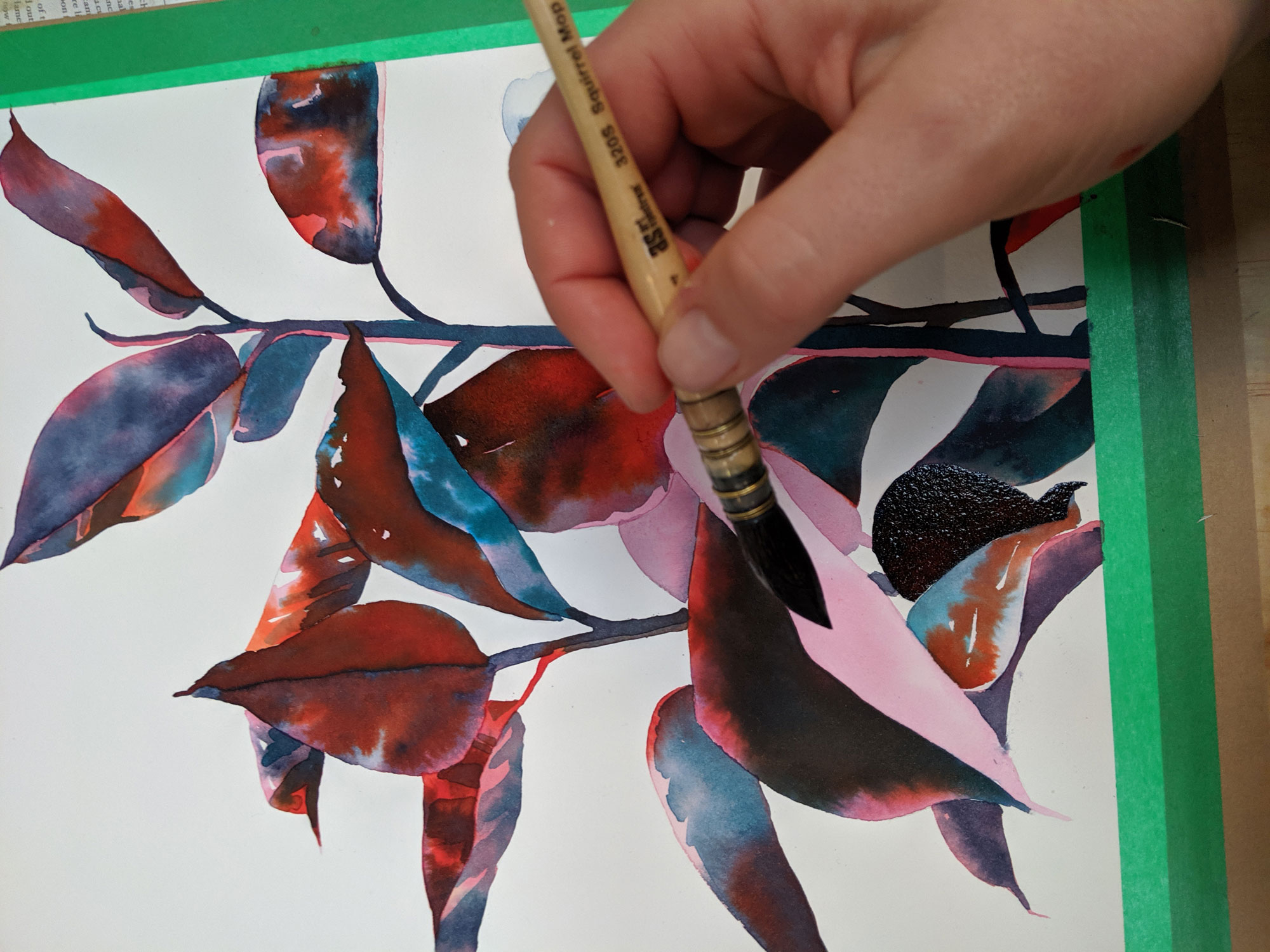 Watercolour painting being painted, featuring an artist's hand and paintbrush.